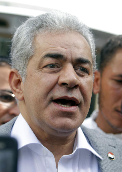 Egyptian opposition leader Hamdeen Sabahi talks to his supporters as anti-riot soldiers prevent opposition activists from getting close to the Shura Council, the upper house of Parliament, during a protest against the new judicial law in Cairo, Egypt, Saturday, May 25, 2013. (AP Photo/ Amr Nabil)