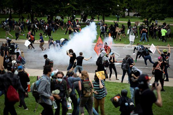 PHOTO: Protesters run after police fired tear gas during a rally in Denver against the death of George Floyd, May 30, 2020. (Alyson Mcclaran/Reuters)