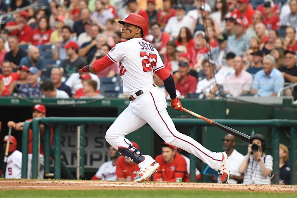 WASHINGTON, DC - JULY 19:  Juan Soto #22 of the Washington Nationals hits a solo home run in the first inning during a baseball game against the Miami Marlins at Nationals Park on July 19, 2021 in Washington, DC.  (Photo by Mitchell Layton/Getty Images)