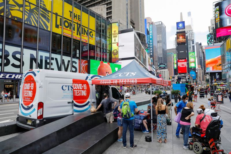 FILE PHOTO: People queue at a popup COVID-19 testing site in Times Square during the outbreak of the coronavirus disease in Manhattan, New York City
