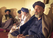 FILE - Hamid Karzai, Afghanistan's interim prime minister, right, meets with tribal leaders from the five southern Afghan states in the house where Taliban supreme leader Mullah Mohammed Omar used to live in Kandahar, Afghanistan, Monday, Dec. 10, 2001. The former Soviet Union marched into Afghanistan on Christmas Eve, 1979, claiming it was invited by the new Afghan communist leader, Babrak Karmal, setting the country on a path of 40 years of seemingly endless wars and conflict. After the Soviets left in humiliation, America was the next great power to wade in. (AP Photo/Jerome Delay)