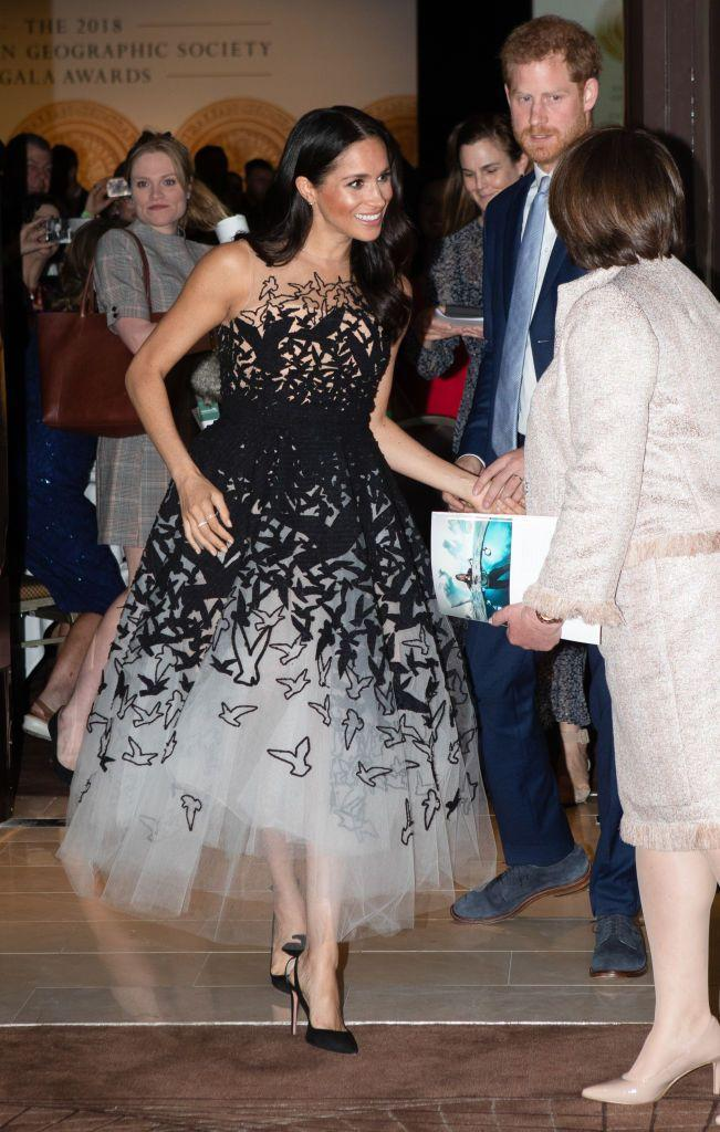 """<p>Stepping out for the Australian Geographic Society Awards with Prince Harry today, the Duchess of Sussex looked like a real-life princess in an Oscar de la Renta Pre-Fall 2018 'Scribble' dress (similar available <a href=""""https://www.farfetch.com/uk/shopping/women/oscar-de-la-renta-sequin-embroidered-starfish-gown-item-12772701.aspx?storeid=11092&size=22&pid=googleadwords_int&af_channel=Search&c=1603618029&af_c_id=1603618029&af_keywords=aud-301601826147%3Apla-381862308126&af_adset_id=66294291332&af_ad_id=305209734647&is_retargeting=true&shopping=yes&gclid=CjwKCAjw9sreBRBAEiwARroYm2SXNRSCdRcCf6Egffi0HaJnfNBhyyd-rBhMamP6lkGBvgxagYnE-xoClmIQAvD_BwE"""" rel=""""nofollow noopener"""" target=""""_blank"""" data-ylk=""""slk:here"""" class=""""link rapid-noclick-resp"""">here</a>).</p>"""