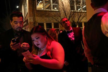 Kumar Srikantappa (Centre R), 31, who is a software architect for Oracle, waits in line to get into a Gatsby-themed party in San Francisco, California, U.S. January 28, 2017. REUTERS/Gabrielle Lurie