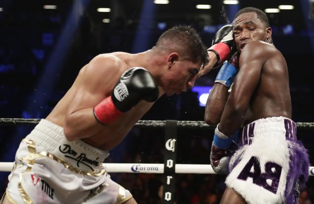 Jessie Vargas, left, punches Adrien Broner during the eighth round of a welterweight boxing match Saturday, April 21, 2018, in New York. (AP Photo/Frank Franklin II)