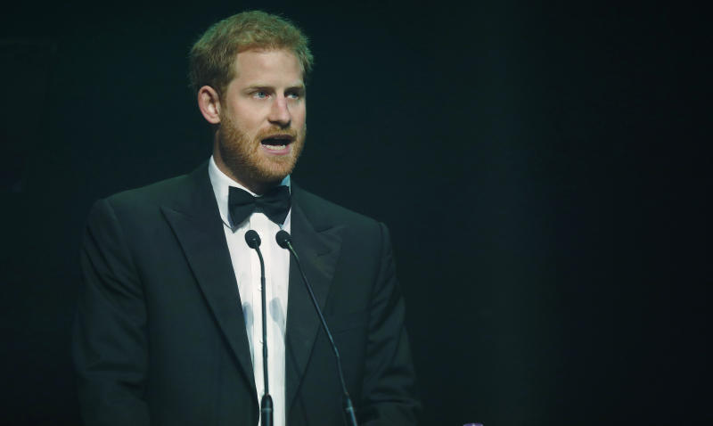 Prince Harry talks after receiving a posthumous Legacy Award on behalf of his mother at the Attitude Awards on October 12, 2017, in London. [Photo: Getty]