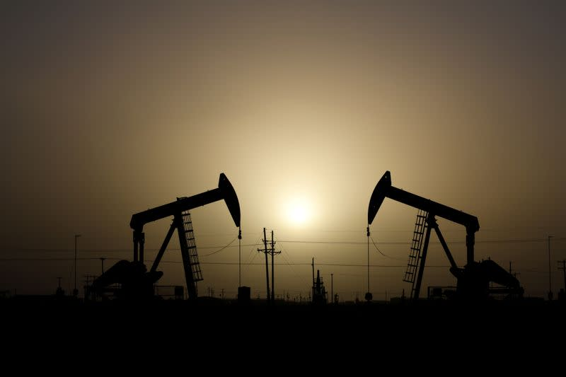 FILE PHOTO: Pump jacks operate at sunset in Midland, Texas