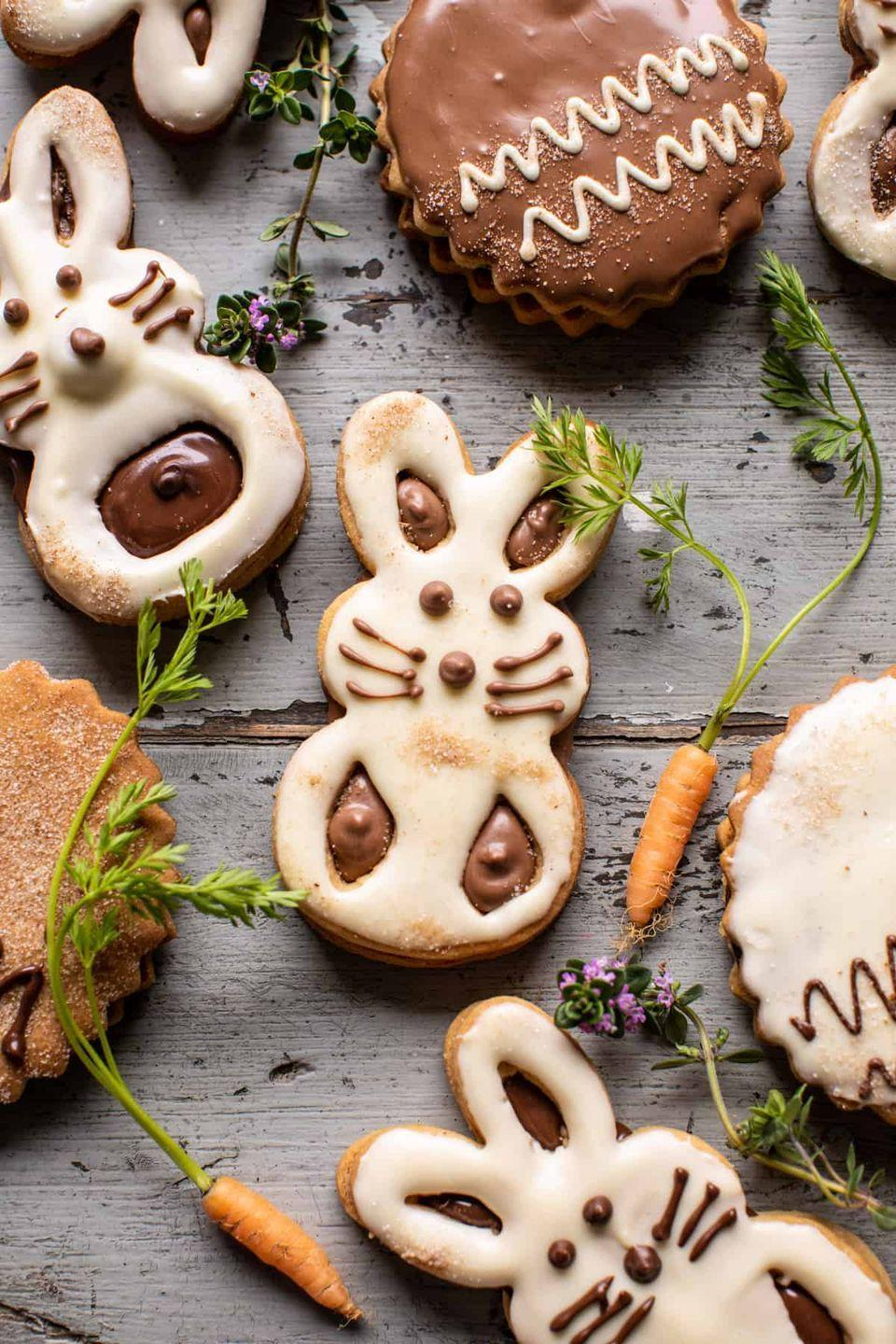 "<p>Not only are these bunny cookies adorable, but they're delicious! Make some shortbread eggs to go along with them.</p><p><strong>Get the recipe at <a href=""https://www.halfbakedharvest.com/milk-chocolate-stuffed-peanut-butter-bunny-cookies/"" rel=""nofollow noopener"" target=""_blank"" data-ylk=""slk:Half Baked Harvest"" class=""link rapid-noclick-resp"">Half Baked Harvest</a>.</strong></p><p><strong><a class=""link rapid-noclick-resp"" href=""https://go.redirectingat.com?id=74968X1596630&url=https%3A%2F%2Fwww.walmart.com%2Fsearch%2F%3Fquery%3Dbunny%2Bcookie%2Bcutter&sref=https%3A%2F%2Fwww.thepioneerwoman.com%2Ffood-cooking%2Fmeals-menus%2Fg35408493%2Feaster-desserts%2F"" rel=""nofollow noopener"" target=""_blank"" data-ylk=""slk:SHOP BUNNY COOKIE CUTTER"">SHOP BUNNY COOKIE CUTTER</a><br></strong></p>"