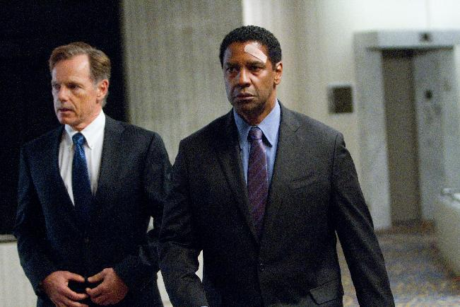 "This film image released by Paramount Pictures shows Bruce Greenwood portraying Charlie Anderson, left, and Denzel Washington portraying Whip Whitaker in a scene from ""Flight."" Washington plays an airline pilot who, despite being hung-over, drunk and coked-up, manages to bring down a rapidly deteriorating plane in a daring emergency landing on what should have been a routine flight between Orlando, Fla., and Atlanta. (AP Photo/Paramount Pictures, Robert Zuckerman)"