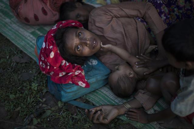 <p>Rohingya Muslim refugees sleep under a makeshift shelter in a clearing in a forest after crossing the border from Myanmar on Sept. 8, 2017 in Gundum, Bangladesh. (Photo: Dan Kitwood/Getty Images) </p>