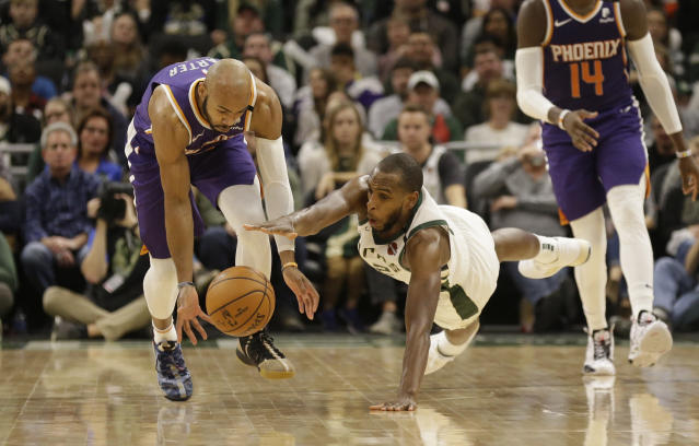 Khris Middleton did his best leading the Bucks, but it wasn't enough on Sunday against the Suns. (AP Photo/Jeffrey Phelps)