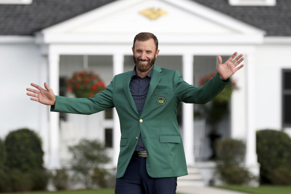 Dustin Johnson reacts after being presented his first green jacket after winning the Masters golf tournament Sunday, Nov. 15, 2020, in Augusta, Ga. (Curtis Compton/Atlanta Journal-Constitution via AP)