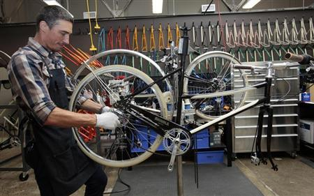 Max Stchelcine assembles a Shinola bicycle at the newly opened Shinola luxury bike and watch store in Detroit