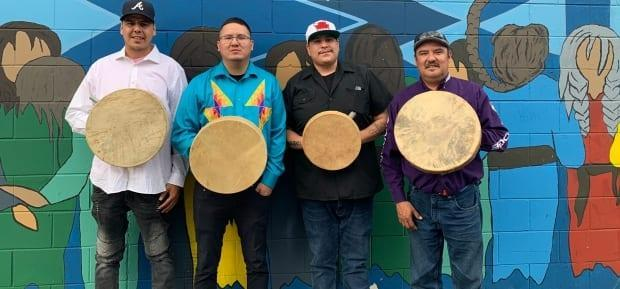 From left to right: Joseph Twist, Jared Bird, Jason Keewatin and Jeff Longman make up the Grey Buffalo drumming group. Bird, Twist, and Longman were in Saskatoon Saturday during the incident. (Submitted by Jared Bird - image credit)