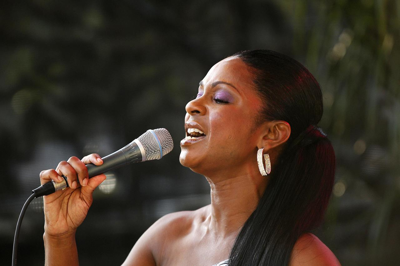 Stephanie Jordan performs at a sunrise concert marking International Jazz Day in New Orleans, Monday, April 30, 2012. The performance, at Congo Square near the French Quarter, is one of two in the United States that day; the other is in the evening in New York. Thousands of people across the globe are expected to participate in International Jazz Day, including events in Belgium, France, Brazil, Algeria and Russia. (AP Photo/Gerald Herbert)