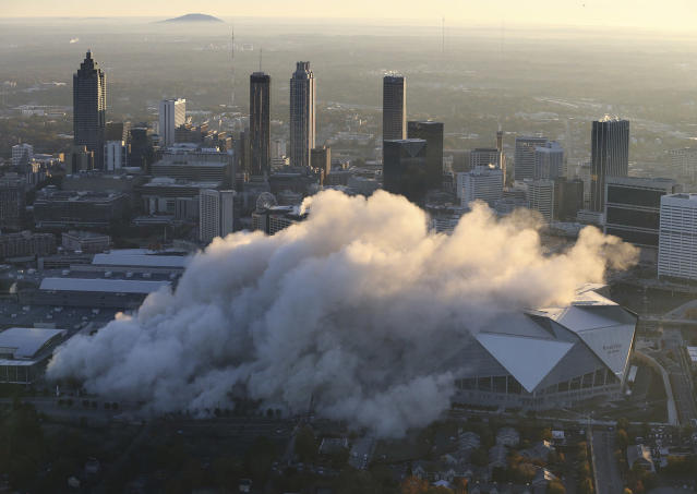 <p>The Georgia Dome is destroyed in a scheduled implosion next to its replacement the Mercedes-Benz Stadium, right, Monday, Nov. 20, 2017, in Atlanta. The dome was not only the former home of the Atlanta Falcons but also the site of two Super Bowls, 1996 Olympics Games events and NCAA basketball tournaments among other major events. (Curtis Compton/Atlanta Journal-Constitution via AP) </p>