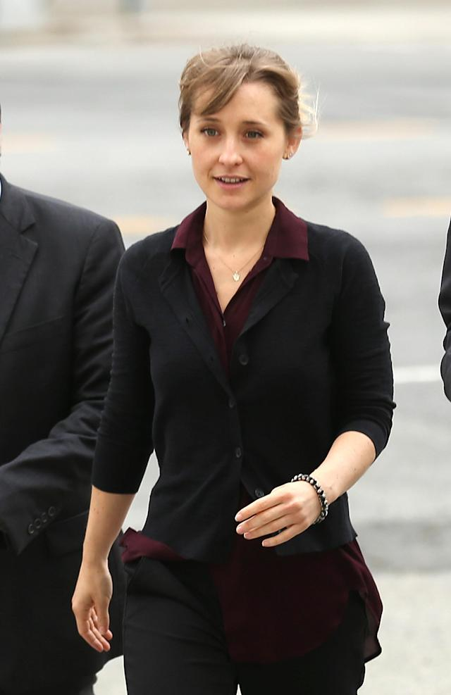 Actress Allison Mack dressed down for court appearances to face sex trafficking charges. (Photo: Getty Images)