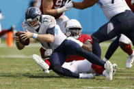 Tennessee Titans quarterback Ryan Tannehill (17) is sacked by Arizona Cardinals defensive end Michael Dogbe in the second half of an NFL football game Sunday, Sept. 12, 2021, in Nashville, Tenn. (AP Photo/Wade Payne)