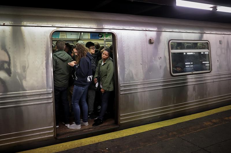 NEW YORK, NY - APRIL 12: Passengers wait for a train to leave the station at the Hoyt-Schermerhorn subway station, April 12, 2018 in the Brooklyn borough of New York City. A fight between customers on a morning A train caused backups through the morning rush. (Photo by Drew Angerer/Getty Images)