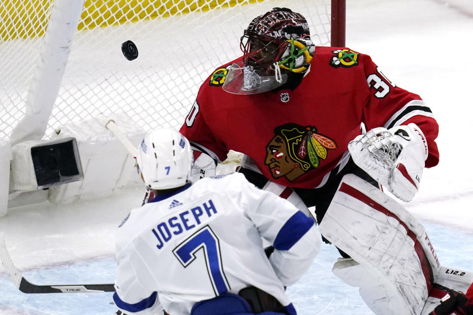 Chicago Blackhawks goalie Malcolm Subban, right, blocks a shot by Tampa Bay Lightning's Mathieu Joseph during the second period of an NHL hockey game in Chicago, Friday, March 5, 2021. (AP Photo/Nam Y. Huh)
