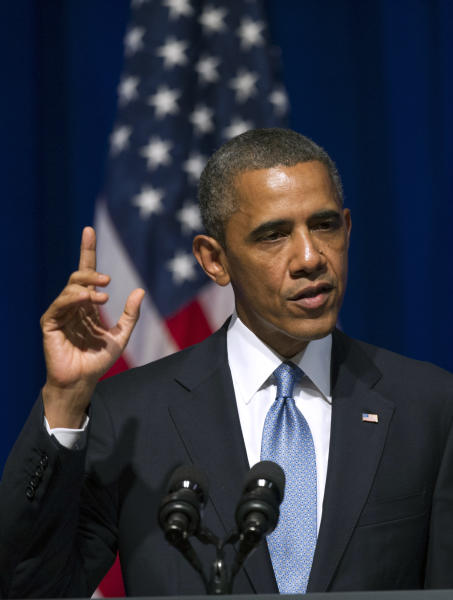 President Barack Obama addresses an Organizing for Action summit in Washington, Monday, July 22, 2013. The group was formed from Obama's 2012 re-election campaign with the express goal of backing his policy priorities. (AP Photo/Cliff Owen)