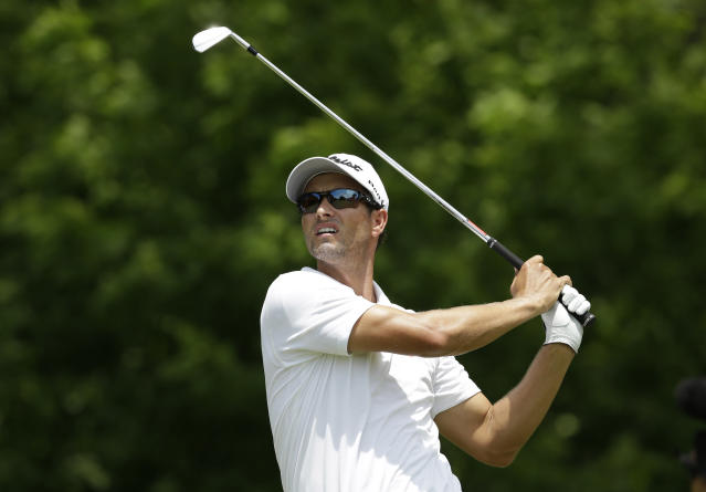 Adam Scott watches his tee shot on the eighth hole during the final round of the PGA Colonial golf tournament in Fort Worth, Texas, Sunday, May 25, 2014. (AP Photo/LM Otero)