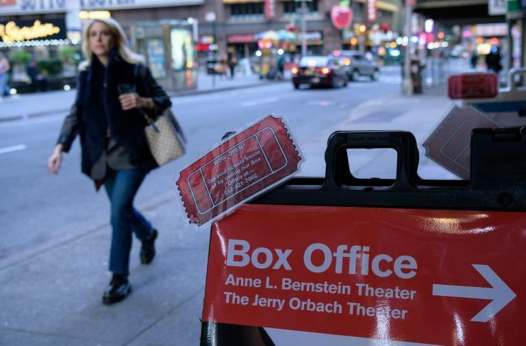 A person walks past a box office sign outside New York's longest running play 'Perfect Crime' on April 27, 2021