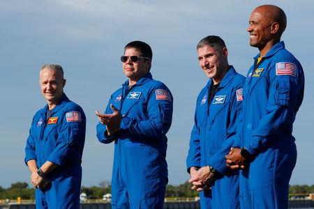 NASA commercial crew astronauts ( L to R ) Doug Hurley, Bob Behnken, Mike Hopkins and Victor Glover speak to the media prior to the launch of a SpaceX Falcon 9 carrying the Crew Dragon spacecraft on an uncrewed test flight to the International Space Station from the Kennedy Space Center in Cape Canaveral, Florida, U.S., March 1, 2019. REUTERS/Mike Blake