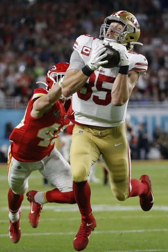 FILE - In this Feb. 2, 2020, file photo, San Francisco 49ers' George Kittle (85) catches a pass in front of Kansas City Chiefs' Daniel Sorensen during the first half of the NFL Super Bowl 54 football game in Miami Gardens, Fla. The play was called back on a penalty by Kittle. Kittle has agreed to a five-year extension with the San Francisco 49ers that reportedly is the richest contract ever at the position. A person familiar with the deal says the sides agreed Thursday, Aug. 13, 2020, on the deal to keep Kittle off the market next offseason. (AP Photo/Mark Humphrey, File)