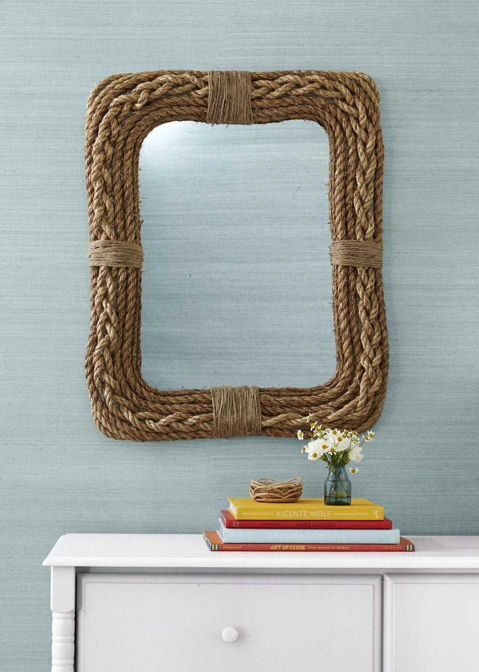<p>Give a boring, ho-hum, mirror new life by covering it in different sizes and colors of rope.<br><strong><br>To make: </strong>Cover frame of a mirror with 1/2- to 3/4-inch manila rope,<br>braiding one section for a decorative effect and adhering rope with hot-glue. Add a decorative band to center of top and sides with thin sisal rope.</p>