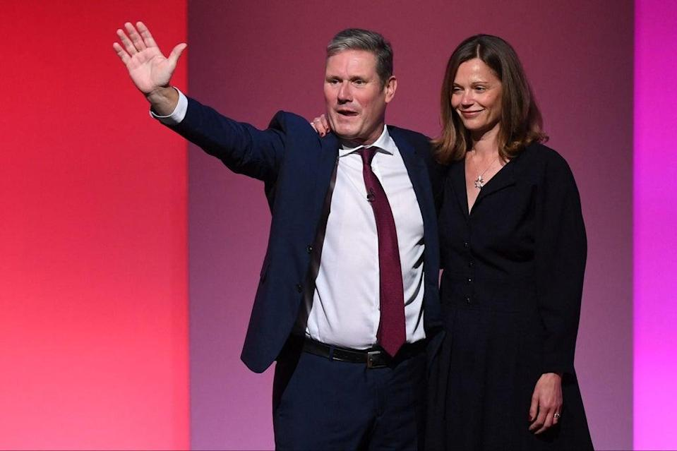Labour leader Keir Starmer is joined by his wife Victoria after giving his speech (AFP via Getty Images)