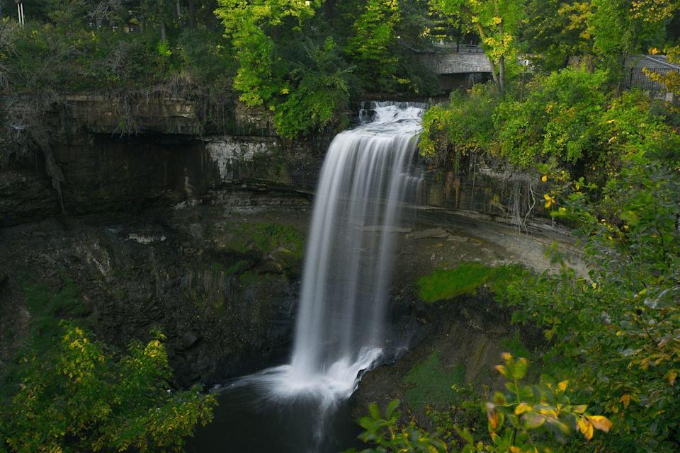 """<p>As the centerpiece of Minneapolis's Minnehaha Regional Park, this 53-foot waterfall is an extraordinary find in the Twin Cities area. Its name, Minnehaha, comes from words meaning """"waterfall"""" in the Dakota language, according to the <a href=""""https://www.minneapolisparks.org/parks__destinations/parks__lakes/minnehaha_regional_park/#group_3_16969"""" rel=""""nofollow noopener"""" target=""""_blank"""" data-ylk=""""slk:Minnesota Parks & Recreation Board"""" class=""""link rapid-noclick-resp"""">Minnesota Parks & Recreation Board</a>.</p>"""