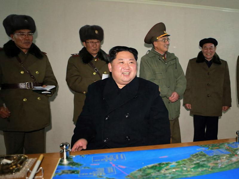 In this photo provided on Thursday, Nov. 30, 2017, by the North Korean government, North Korean leader Kim Jong Un inspects an intercontinental ballistic missile test in North Korea on Wednesday, Nov. 29: Korean Central News Agency/Korea News Service via AP