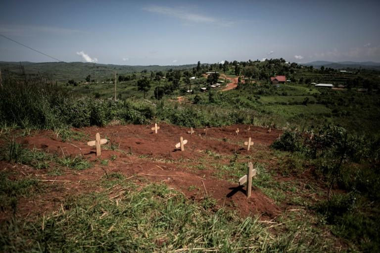 The graves of DR Congo soldiers are pictured outside a base in Djugu, DR Congo in July 2019
