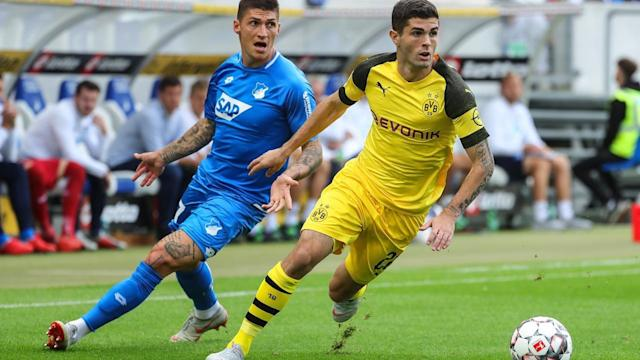 U.S. star Christian Pulisic (R) scored two huge goals for Borussia Dortmund last week.
