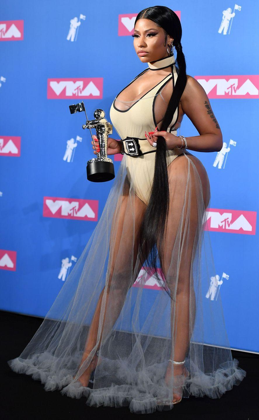 <p>Nicki modeled the hell outta this Off-White tulle dress with a beige bodysuit after she picked up the award for Best Hip-Hop Video. (Also, just look at her extra-long pigtails?!) </p>