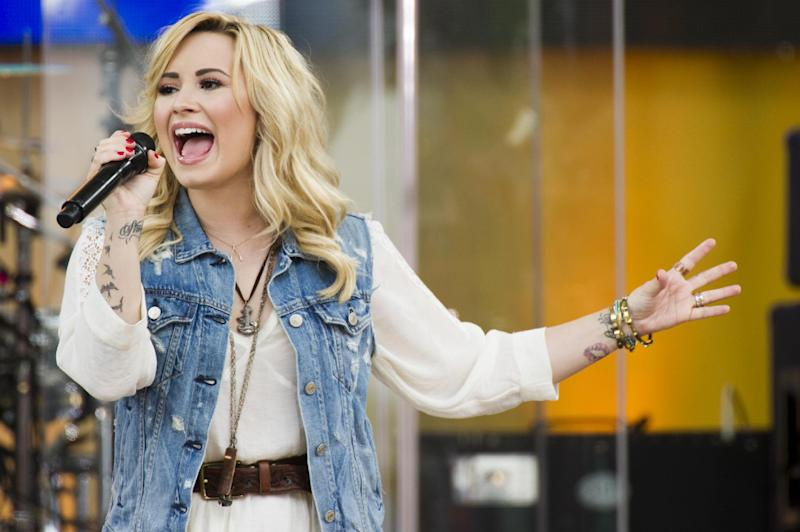"""FILE - In this June 28, 2013 file photo, Demi Lovato performs on ABC's """"Good Morning America,""""  in New York. Philadelphia's Office of City Representatives says Lovato has canceled her appearance at Thursday's Fourth of July concert because of strep throat. She's being replaced by 22-year-old country singer Hunter Hays. (Photo by Charles Sykes/Invision/AP, File)"""