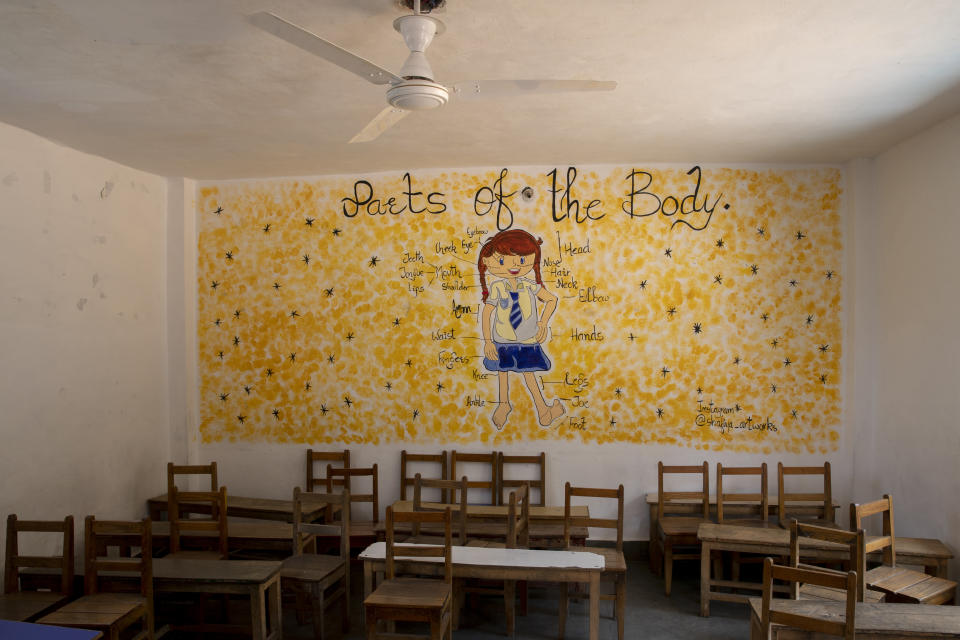 Chairs and benches lie inside an empty classroom of a private school that has remained closed for the past four months because of the coronavirus pandemic in Srinagar, Indian controlled Kashmir, Wednesday, July 22, 2020. Decades of insurgency, protests and military crackdowns have constantly disrupted formal schooling in Indian-administered Kashmir, where rebels have fought for decades for independence or unification with Pakistan, which controls the other part of the Muslim-majority region. A generation of students have seen their education upended, and empty classrooms are a familiar sight. (AP Photo/Dar Yasin)