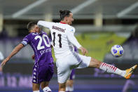 AC Milan's Zlatan Ibrahimovic vies for the ball with Fiorentina's German Pezzella, right, during a Serie A soccer match between Fiorentina and AC Milan, in Florence's Artemio Franchi stadium, Italy, Sunday, March 21, 2021. (Spada/LaPresse via AP)