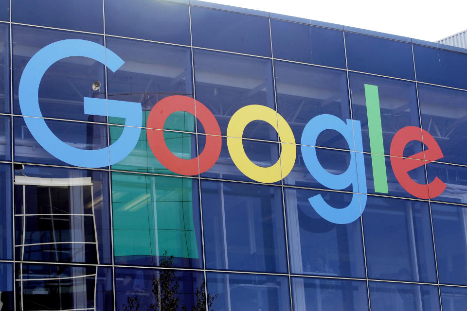 FILE - In this Sept. 24, 2019, file photo a sign is shown on a Google building at their campus in Mountain View, Calif. Google is once again postponing a return to the office for most workers until mid-January 2022. The internet search giant is also to requiring all employees to be vaccinated once its sprawling campuses are fully reopened. (AP Photo/Jeff Chiu, File)