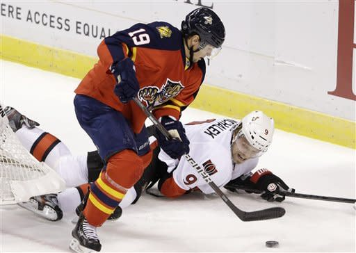 Florida Panthers right wing Scottie Upshall (19) battles for the puck with Ottawa Senators left wing Milan Michalek (9), of the Czech Republic, during the first period of an NHL hockey game, Thursday, Jan. 24, 2013, in Sunrise, Fla. (AP Photo/Wilfredo Lee)