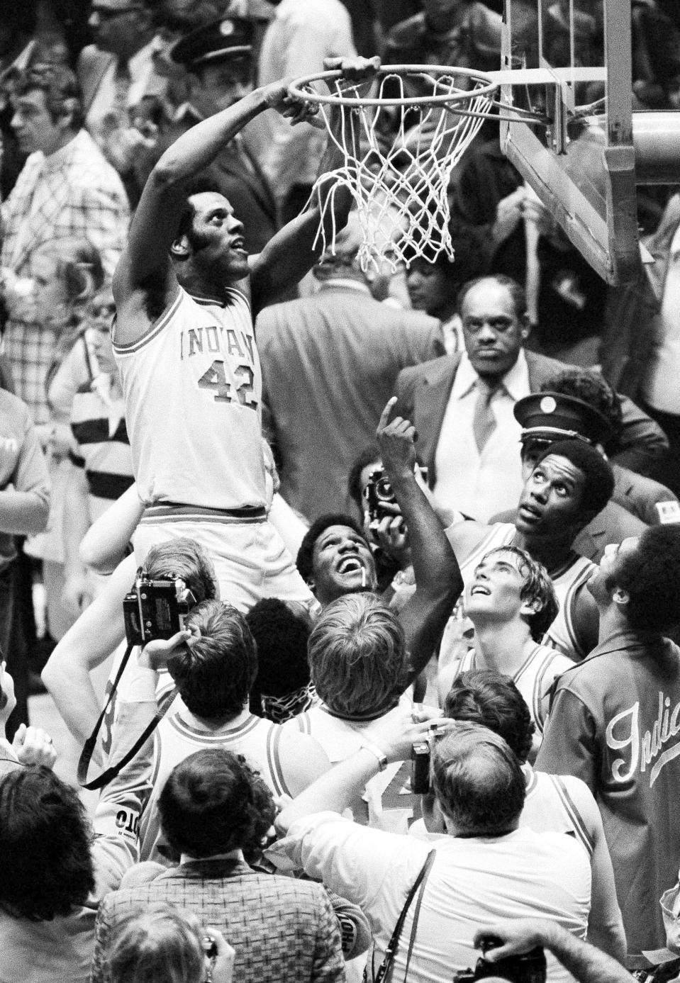 FILE - Indiana's Scott May (42) cuts the net after Indiana beat Michigan 86-68 in the NCAA college basketball championship game in Philadelphia, in this March 30, 1976, file photo. (AP Photo/File)