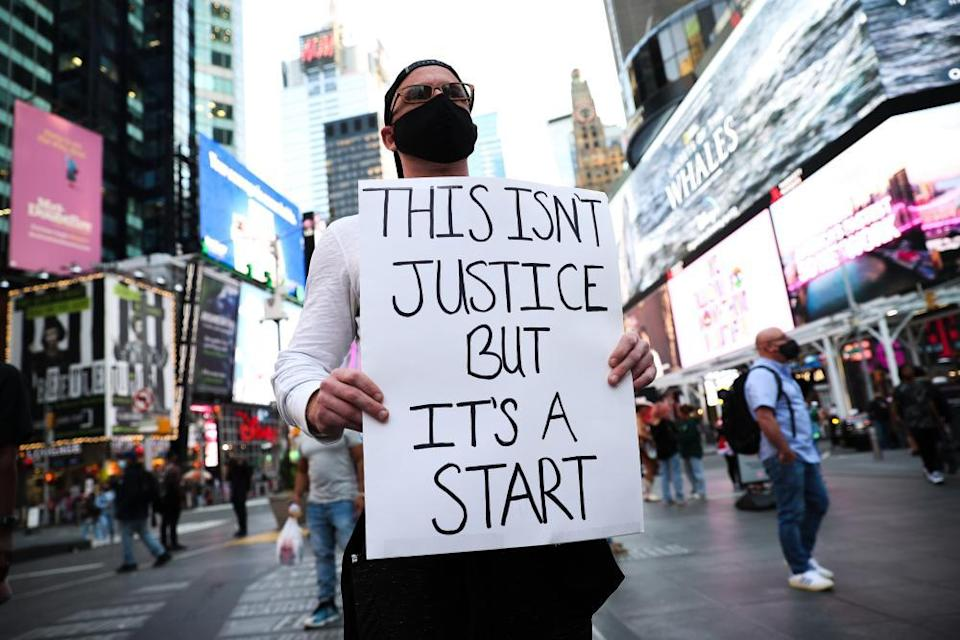 Black Lives Matter demonstrators gather in Times Square in New York City after the Derek Chauvin verdict.