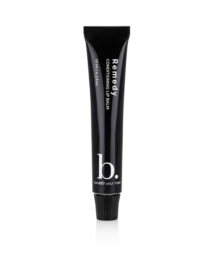 "Get the <a href=""https://beneathyourmask.com/collections/our-collection/products/remedy-conditioning-lip-balm"" rel=""nofollow noopener"" target=""_blank"" data-ylk=""slk:Beneath Your Mask remedy conditioning lip balm for $22"" class=""link rapid-noclick-resp"">Beneath Your Mask remedy conditioning lip balm for $22</a>."