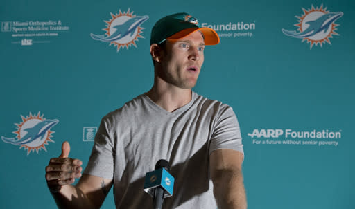 Miami Dolphins quarterback Ryan Tannehill gestures as he speaks during a news conference after an NFL organized team activities football practice, Wednesday, May 23, 2018, at the Dolphins training facility in Davie, Fla. Tannehill returns to the Dolphins' practice field this week for OTAs optimistic he can stay healthy after suffering a serious knee injury each of the past two years. (AP Photo/Wilfredo Lee)