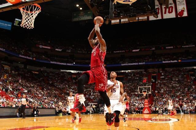 MIAMI, FL - DECEMBER 23: LeBron James #6 of the Miami Heat rises for a dunk against the Atlanta Hawks on December 23, 2013 at American Airlines Arena in Miami, Florida. (Photo by Issac Baldizon/NBAE via Getty Images)