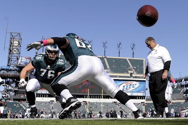 Philadelphia Eagles center Jason Kelce (62), center, works on his blocking with tackle Allen Barbre (76) after snapping the ball before an NFL football game against the Dallas Cowboys, Sunday, Oct. 20, 2013, in Philadelphia. (AP Photo/Michael Perez)