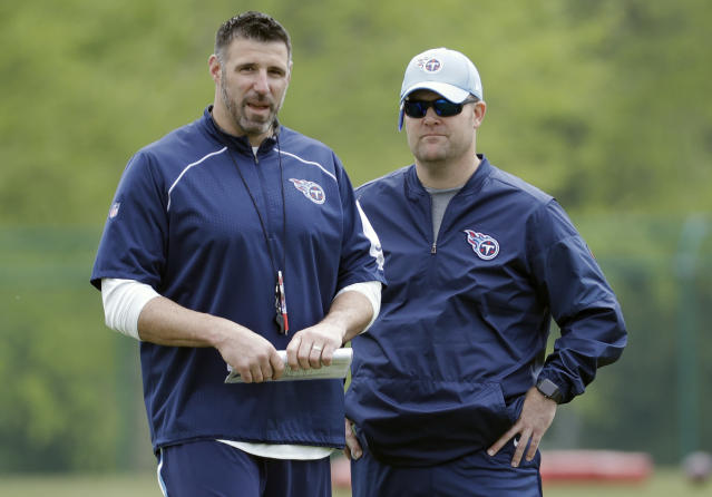Tennessee Titans head coach Mike Vrabel, left, talks with general manager Jon Robinson during a voluntary practice at its NFL football training facility Wednesday, April 25, 2018, in Nashville, Tenn. (AP Photo/Mark Humphrey)