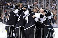 LOS ANGELES, CA - JUNE 11: Anze Kopitar #11 of the Los Angeles Kings jumps on teammates captain Dustin Brown #23, Jarret Stoll #28, Jordan Nolan #71, Colin Fraser #24, Rob Scuderi #7, Drew Doughty #8 and goaltender Jonathan Quick #32 of the Los Angeles Kings after winning Game Six of the 2012 Stanley Cup Final 6-1 to win the series 4-2 at Staples Center on June 11, 2012 in Los Angeles, California. (Photo by Harry How/Getty Images)