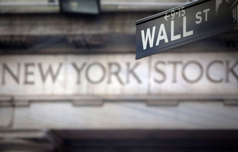 FILE PHOTO: FILE PHOTO: A Wall Street sign outside the New York Stock Exchange