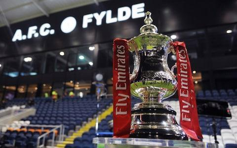 The draw for the third round of the FA Cup has produced a series of major derbies, including a first match at this stage of the competition since 1932 between Liverpool and Everton. Jurgen Klopp and Sam Allardyce's teams were paired together during Monday night's draw, as were Premier League rivals Crystal Palace and Brighton and Hove Albion. North-East neighbours Sunderland and Middlesbrough, who have both been relegated in recent years to the Championship, were also drawn together. Arsenal, who are attempting to win the trophy for a fourth time in five years, will begin their defence at Nottingham Forest. Other especially eye-catching fixtures include AFC Wimbledon's return to Wembley in the FA Cup some 30 years on from their memorable triumph in 1988 to face Tottenham Hotspur. Luton Town, now of League Two and the FA Cup finalists in 1959, also have glamorous away Premier League opponents in Newcastle United. Premier League leaders Manchester City have a tricky home tie against Sean Dyche's Burnley, while Manchester United host Derby County and Chelsea are away at Norwich City. Who will be lifting the FA Cup come what May? Credit: Getty Images Hereford, who are in the seventh tier of the football pyramid, will face 2016 Premier League champions Leicester City if they manage to overcome Fleetwood in their second-round replay. Four non-league sides were involved in the draw, which was conducted by Glenn Hoddle and Jermain Jenas ahead of the second-round match between Slough Town and Rochdale, but none are currently guaranteed a place in the third round. National League club AFC Fylde will have the opportunity to face Premier League opposition in Bournemouth if they beat Wigan Athletic in their replay. Woking, who also play in the fifth tier of the pyramid, have the chance to play at Villa Park against Aston Villa if they beat Peterborough in their replay. The ties will take place on Jan 5-7, with timings dependent on which matches are selected for live screening by BBC and BT Sport. There was criticism last year that broadcasters often opted to show big Premier League clubs rather than the more romantic ties, such as the third-round fixture between non-league Sutton United and AFC Wimbledon. Sutton did eventually make it to a televised tie against Arsenal in the fifth round. Arsenal subsequently beat Manchester City and Chelsea in the semi-final and final to win what was a record 13th FA Cup. The draw in full: Ipswich v Sheffield United Watford v Bristol City Birmingham v Burton Liverpool v Everton Brighton v Crystal Palace Aston Villa v Woking or Peterborough Bournemouth v AFC Fylde or Wigan Coventry v Stoke Arsene Wenger's Arsenal travel to Nottingham Forest Newport v Leeds Bolton v Huddersfield Port Vale or Yeovil v Bradford Nottingham Forest v Arsenal Brentford v Notts County QPR v MK Dons Manchester United v Derby Forest Green or Exeter v West Brom Doncaster v Slough Town or Rochdale Tottenham v AFC Wimbledon Middlesbrough v Sunderland Fleetwood or Hereford v Leicester Blackburn or Crewe v Hull Cardiff v Mansfield Manchester City v Burnley Shrewsbury v West Ham Wolves v Swansea Stevenage v Reading Newcastle v Luton Millwall v Barnsley Fulham v Southampton Wycombe v Preston Norwich v Chelsea Gillingham or Carlisle v Sheffield Wednesday Ties to be played January 5-7 7:27PM One for the ages? Another exciting looking tie is 2016 Premier League champions away at Hereford United (if Hereford can win their replay against Fleetwood Town. 7:23PM That concludes the draw No doubts about the tie of the round there...Liverpool will host Everton! There's also Brighton vs Crystal Palace and Bournemouth at home against non-league Fylde or Wigan. 7:22PM Last up Gillingham or Carlisle vs Sheffield Wednesday 7:21PM Tough draw Norwich Norwich City vs Chelsea 7:21PM Next Wycombe Wanderers vs Preston North End 7:21PM Next up Fulham vs Southampton 7:21PM All-Championship tie Millwall vs Barnsley 7:20PM Home banker? Newcastle vs Luton Town 7:20PM Next up Stevenage vs Reading 7:20PM The home side could be the favourites here Wolves vs Swansea 7:20PM Another giant-killing for Shrewsbury? Shrewsbury Town vs West Ham 7:20PM All Premier League tie Manchester City vs Burnley 7:19PM Next up Cardiff City vs Mansfield Town 7:19PM Upset alert Blackburn or Crewe vs Hull City 7:19PM Great draw Fleetwood Town or Hereford vs Leicester City 7:19PM Tees-Wear derby Middlesbrough vs Sunderland 7:18PM London derby Tottenham Hotspur vs AFC Wimbledon 7:18PM The Slough fans seem a bit upset... Doncaster Rovers vs Slough Town or Rochdale 7:18PM Banana skin? Forest Green Rovers or Exeter City vs West Brom 7:17PM United are up against... Manchester United vs Derby County 7:17PM Next up QPR vs MK Dons 7:17PM Next up Brentford vs Notts County 7:16PM The holders will play... Nottingham Forest vs Arsenal 7:16PM Next Port Vale or Yeovil Town v Bradford City 7:16PM Local derby Bolton Wanderers vs Huddersfield Town 7:16PM Next up Newport County vs Leeds United 7:16PM A tale of two cities Coventry City vs Stoke City 7:15PM Potentially a huge trip for non-league Fylde Bournemouth vs AFC Fylde or Wigan 7:15PM Less exciting Aston Villa vs Woking or Peterborough United 7:15PM And another big rivalry! Brighton vs Crystal Palace 7:14PM Would you believe it?! Liverpool vs Everton 7:14PM Next Birmingham City vs Burton Albion 7:14PM Next Watford vs Bristol City 7:14PM First up Ipswich Town vs Sheffield United 7:12PM Here we go Jake Humphrey is the host, and the venue is Slough Town's home ground Holloways Park ahead of Slough's FA Cup second round match tonight against Rochdale. Glenn Hoddle and Jermaine Jenas will make the draw. 7:01PM Nearly there The draw will be getting under way in around about 10 minutes. Hereford v Newcastle? Wrexham v Arsenal? Sutton v Coventry? Yep, the BBC's montage has them all. 6:28PM An English institution Evening all, Welcome to our coverage of one of the great days in the English sporting calendar. Yes we are just minutes away from seeing which lower-league teams will get a chance to lose 3-0 against the second string of one of the Premier League's leading lights. For these part-time plumbers and postmen, the opportunity to test themselves against Mohamed Elneny and Matteo Darmian is just a draw of a ball away. There is also the opportunity to be patronised the hell out of by BBC commentators and possibly go down in football folklore for ever more. Think Ronny Radford scoring for Hereford against Newcastle, Mickey Thomas for Wrexham against Arsenal, er Nigel Jemson for Shrewsbury against Everton. The third round stage is of course when all the Premier League and Championship teams join the competition, and alongside them will be four non-league teams in the pot - AFC Fylde, Hereford, Slough and Woking. Arsenal are the current FA Cup holders Credit: AP Woking you may recall have some pedigree in this competition. In January 1991 the Surrey-based side pulled off one of the great FA Cup shocks when as a Conference team they knocked out second-tier outfit West Brom 4-2 at the Hawthorns. They were then beaten 1-0 by top-flight side Everton in the fourth round. More recently, Woking reached the third round in 1997 and took Premier League side Coventry to a replay which they narrowly lost 2-1. But enough about Woking. Tonight's draw gets under way at around 7pm, and precedes the second round match between seventh-tier Slough Town and League One side Rochdale. Here are the ball numbers in full: Bournemouth Arsenal Aston Villa Barnsley Birmingham City Bolton Brentford Brighton Bristol City Burnley Burton Albion Cardiff City Chelsea Crystal Palace Derby County Everton Fulham Huddersfield Hull City Ipswich Town Leeds United Leicester Liverpool Manchester City Manchester United Middlesbrough Millwall Newcastle Norwich City Nottingham Forest Preston North End QPR Reading Sheffield United Sheffield Wednesday Southampton Stoke Sunderland Swansea Tottenham Watford West Brom West Ham Wolves Woking or Peterborough MK Dons Newport County Wycombe Wanderers Port Vale/Yeovil Shrewsbury Town Doncaster Rovers Slough Town or Rochdale AFC Wimbledon Stevenage Mansfield Town Luton Town Bradford City Blackburn/Crewe AFC Fylde or Wigan Gillingham or Carlisle Notts County Forest Green Rovers or Exeter City Fleetwood Town or Hereford Coventry City